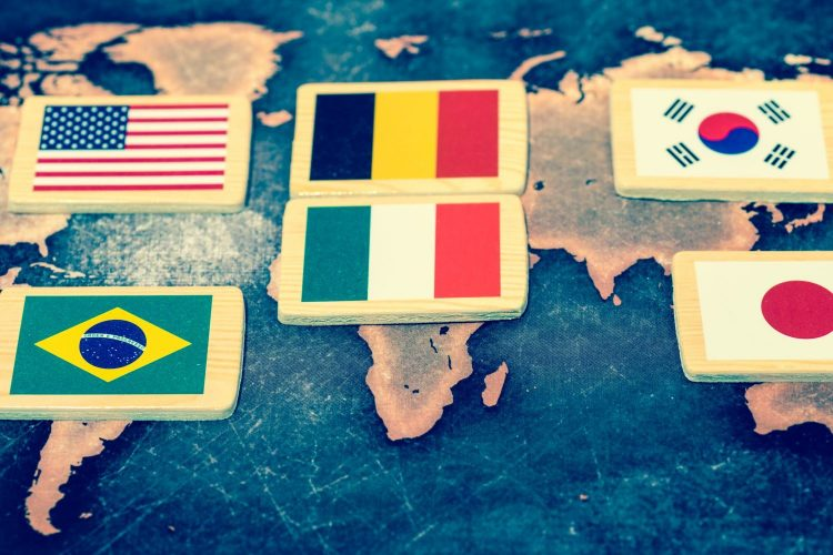 World flags on grunge world map